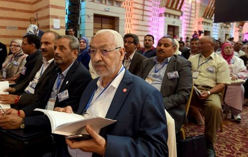 Tunisian Islamist Ennahdha Party leader Rached Ghannouchi (C) attends the discussions on May 22, 2016, in Hammamet on the third-day of the Ennahdha congress. Around 1,200 Ennahda delegates will meet over the weekend in Hammamet, south of Tunis, to discuss the party's future and adopt economic, political and social roadmaps. / AFP PHOTO / FETHI BELAID
