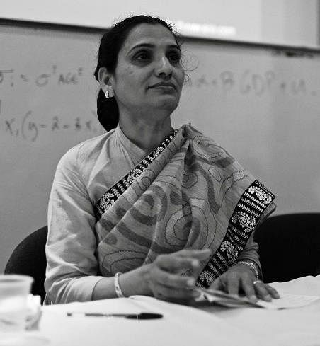 Black and white image of Indian Woman sitting at a table