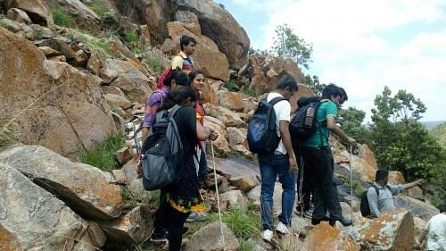 One blind and one hearing-impared participant is teamed with one volunteer for the trek