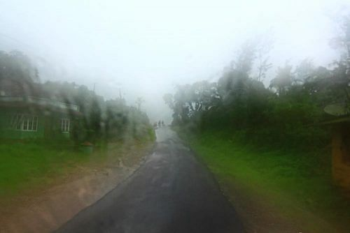 coorg_cycling_rain_zps34c5af67