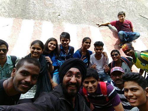 The trekkers take a selfie at the big boulder in Ramanagara