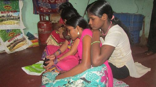 Girls chilling out in the hostel in Bhubaneswar. (Credit: Rakhi Ghosh\WFS)