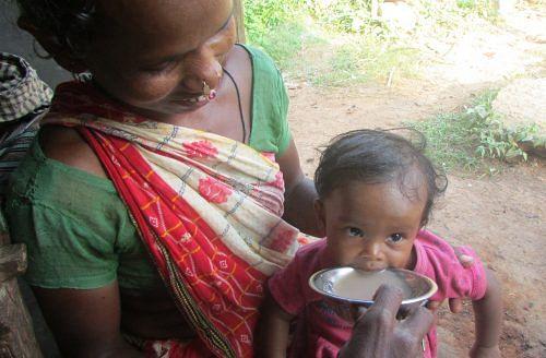 A tribal woman feeding her son nutritious ragi soup. (Credit: Rakhi Ghosh\WFS)