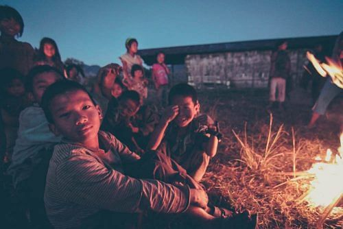 Children of the Chief and the villagers, hanging out by the bonfire in the church grounds of Longwa, a remote Konyak Naga village situated on the Indo-Myanmar border
