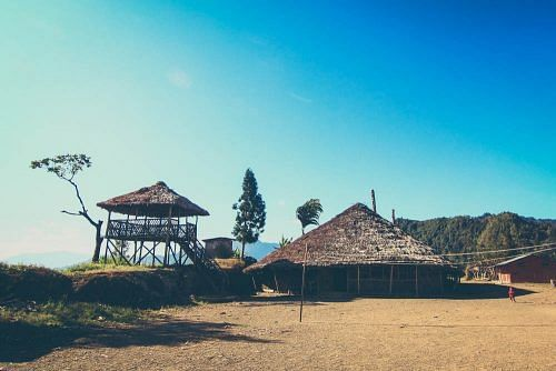 """House of the Village Chief, or """"Angh"""". It lies half in India and half in Myanmar. The international border cuts across the house longitudinally!"""
