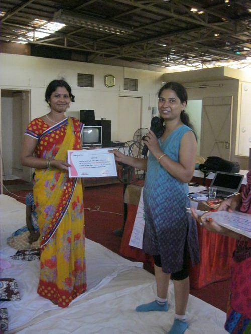 nirmala-devi-getting-a-certificate-after-training