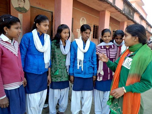 Nisha in discussion with her girls at a local school