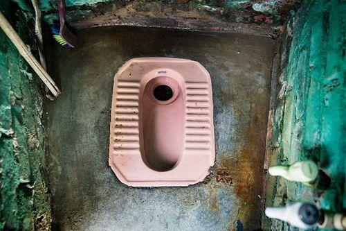 A household toilet in Safeda Basti slum, New Delhi, India. Photo Credit: WaterAid/Adam Ferguson