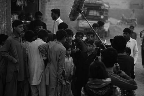 Sabiha interacting with people on the streets of Pakistan