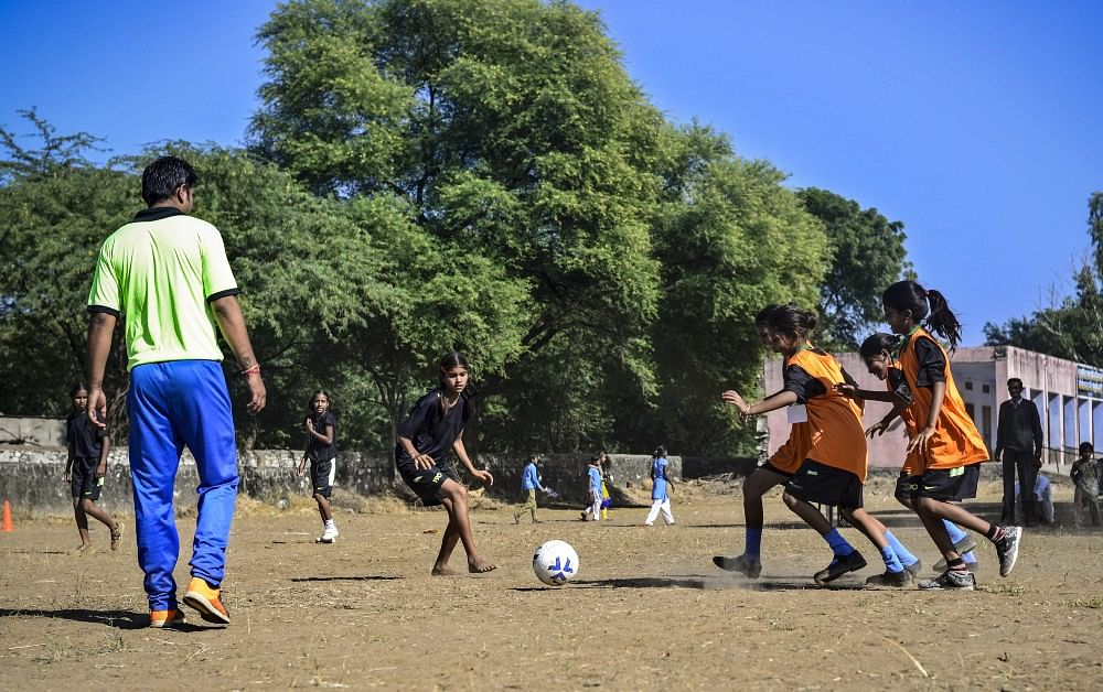 Girls play a friendly match during football camp, in Meeno Ka Naya Gaon.