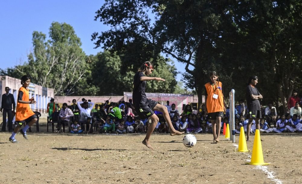 Girls play a friendly match during football camp, in Meeno Ka Naya Gaon.