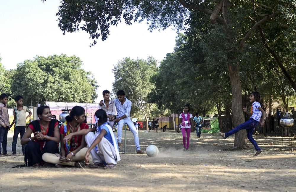 12—year—old and student of class 6th Aarti found an opportunity to grab the ball during break time, in Meeno Ka Naya Gaon.