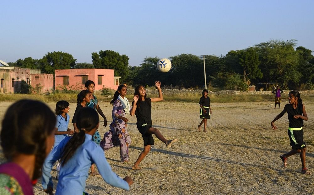 Smita juggle the ball during practice, in Sakariya.