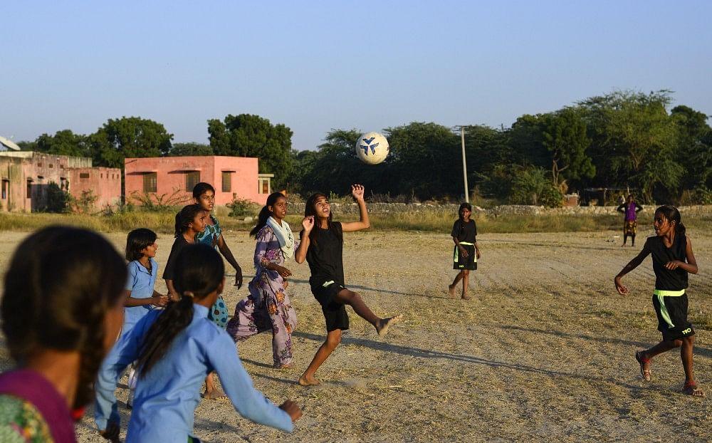 Smita juggle the ball during practice, in Sakariya.