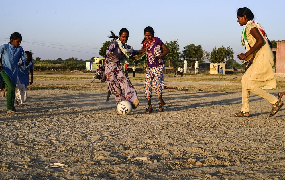 15 — year — old Bhagwati kicks the ball during evening practice, in Sakariya.