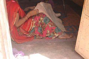 Artisan stitching the pattern for the Jodhpuri chappal