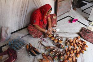 The last touch before packing the Jodhpuri chappals, out for sale