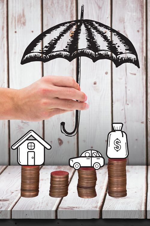 composite of umbrella graphic over cash graphics with wood background