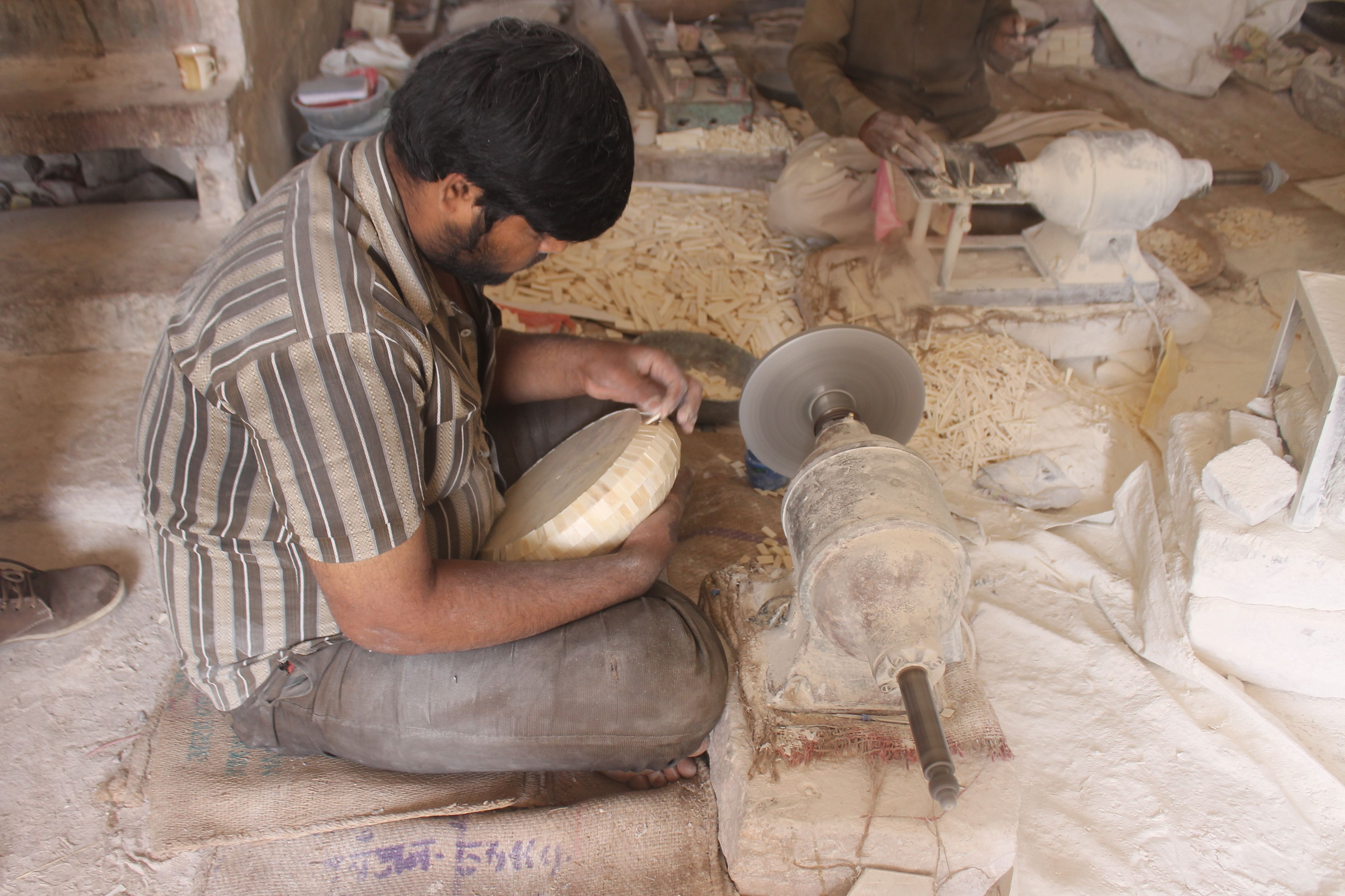 Camel Bone Artist at work