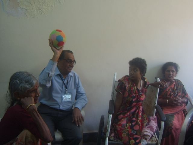 Ramaswamy lifts the spirits of patient and family in a hospital