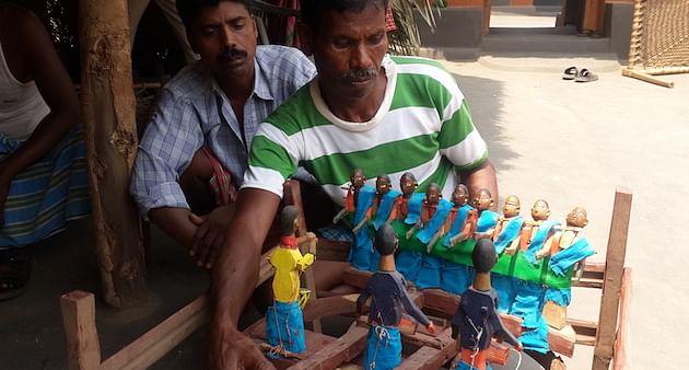 Babudhan Murmu with a set for a Chador Badoni show. (Photo by Channdosree)
