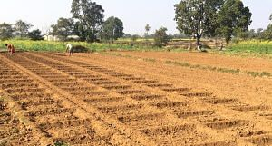 Farmers preparing a small field to grow vegetables in Jharkhand. (Photo by Bikalp Chamola)