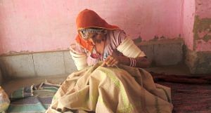 Paaro Bai of Dandkala village in Bikaner doing Kashida embroidery