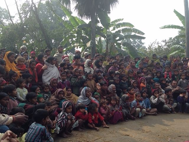 The village community in rapt attention
