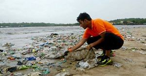Afroz Shah, collecting litter on the beach. Picture Courtesy: Facebook.