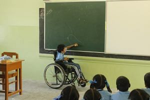 Jayakumar, who is paralysed neck down and has marginal use of his hands, uses his training at the rehabilitation centre to full effect in school.