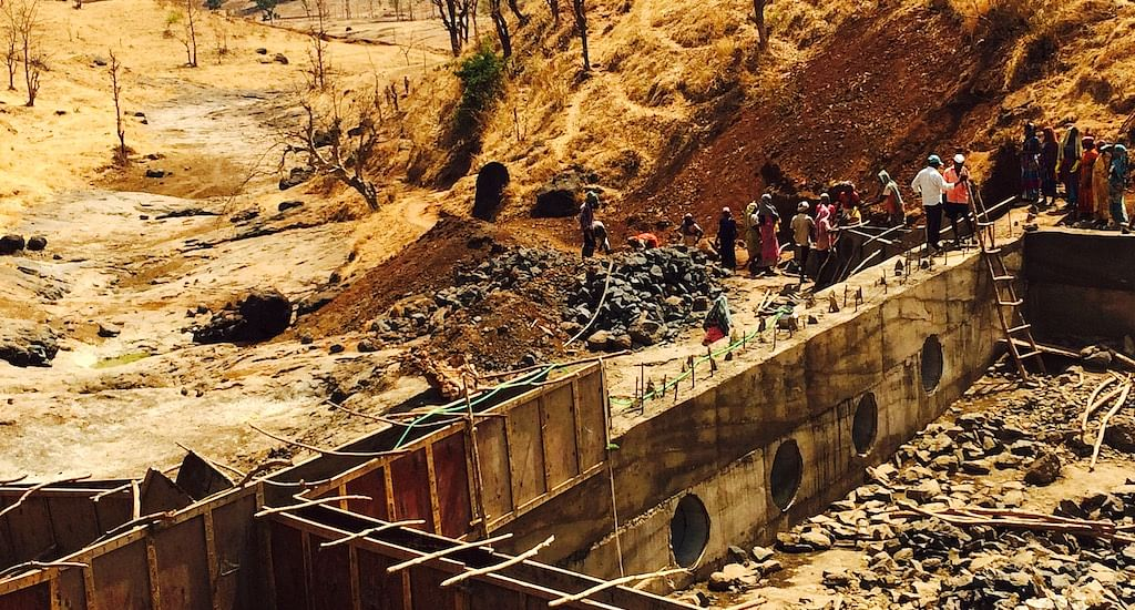 Residents of Bhetwadi contributed voluntary labor to construct the concrete bund with vents. (Photo by Nidhi Jamwal)