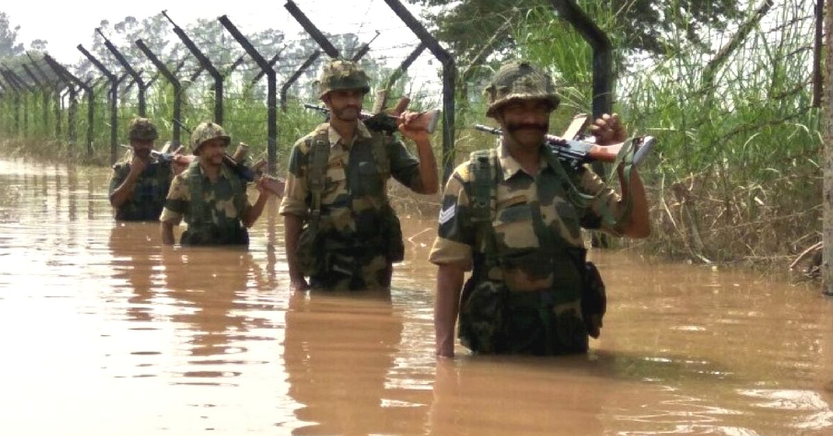 In Pictures: BSF Jawans Brave Floods, Guard Border in Waist-Deep Water in North Bengal