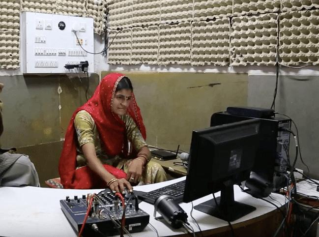 woman editing radio program at Barefoot College