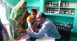 A doctor attends to patients at Gaon Dawakhana, the community-owned village clinic that runs on family subscriptions. (Photo by Lokpriya Janhit Sewa Sansthan)