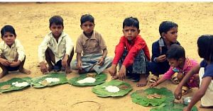 Children eating a meal. Picture for representative purposes only. Picture Courtesy: Wikimedia Commons.