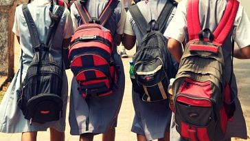 Children carry extremely heavy school bags. Picture Courtesy: Wikimedia Commons.