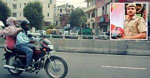 Delhi Cop - free helmets