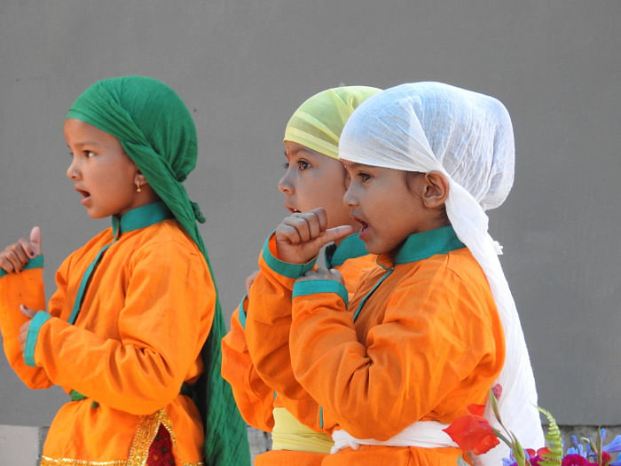 Students performing a Kumaoni Dance for a cultural performance. (Source; Chirag School)