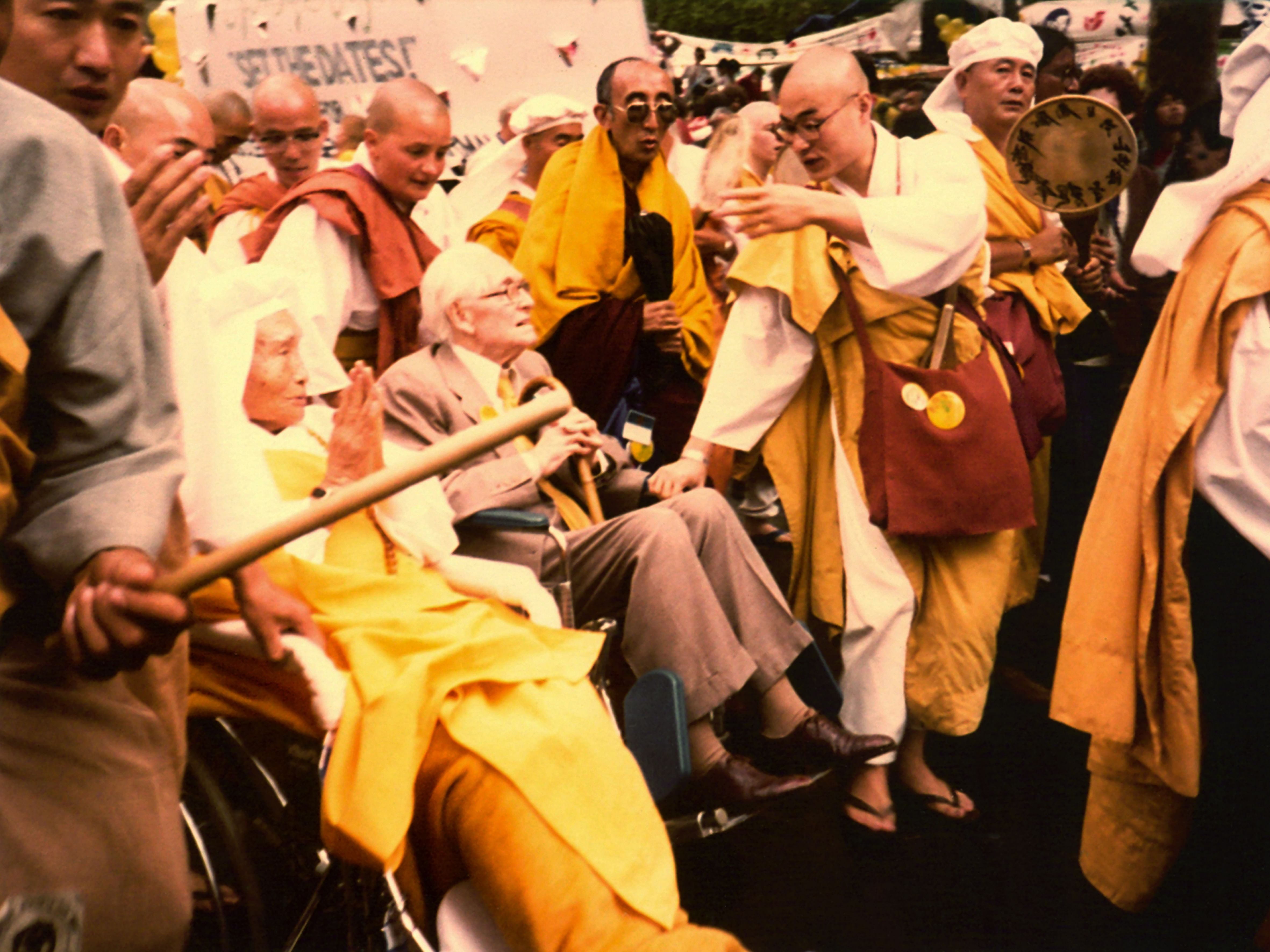 Most Ven Nichidatsu Fujii Guruji (on the wheelchair with folded hands), Lord Philip Noel Barker and Ven Bakula Rinpoche (in dark glasses) at a march on Central Park in New York in 1982 during the United Nations special session on disarmament. (Source: Sonam Wangchuk)