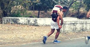 Chirag Arora carried his teammate on his back, and crossed the finishing line. Image Courtesy:- Twitter.