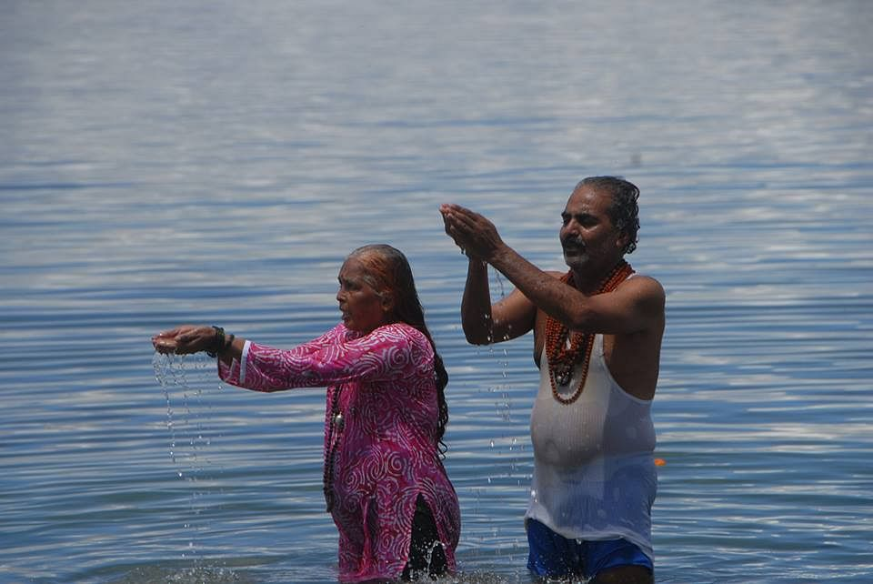 Pilgrims take a dip in Mansarovar Lake (Source: Facebook)