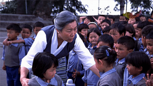 Ama Jetsun Pema with group of Kids at UTCV in early 1990s. (Source: Facebook)
