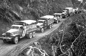 U.S-built Army trucks wind along the side of the mountain over the Ledo supply road. (Source: Wikimedia Commons)
