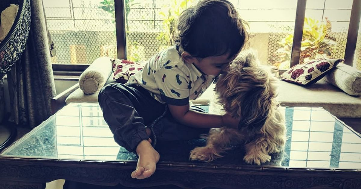 A dog is the best friend a child can ever have! Image Courtesy: Paws, We Care.