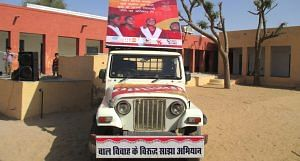 The campaign van roams the desert, spreading awareness about child marriage. (Photo by Tarun Kanti Bose)