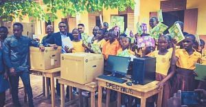 Richard Appiah Akoto (second from left) and his students receive computers donated to their school. (Source: Facebook/NIITGhana)