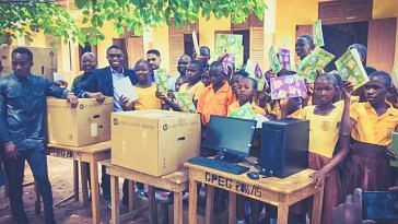 Richard Appiah Akoto (second from left) and his students receive computers donated to their school. (Source: Facebook/NIIT Ghana)