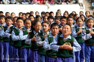 Group of TCV children singing a song during the 53rd TCV Founding Anniversary in 2013 in Dharamshala (Facebook)