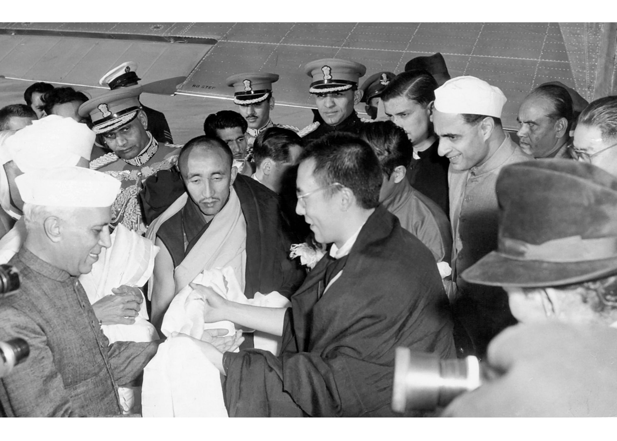 HH The 14th Dalai Lama being received at Palam by Indian dignitaries in Nov 1956.