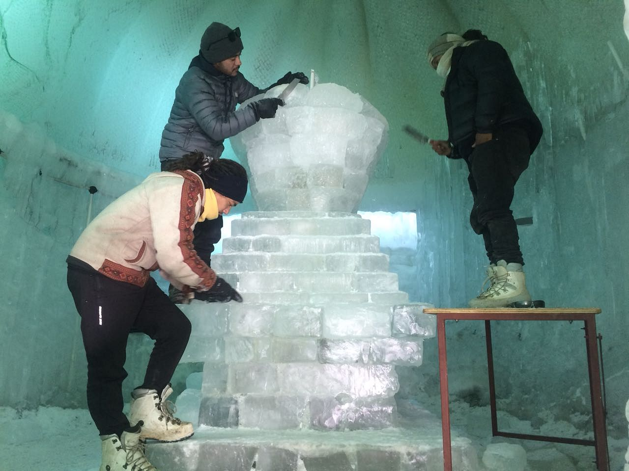 The three artists working on the Ice Chorten (Source: Tsering Gurmet)